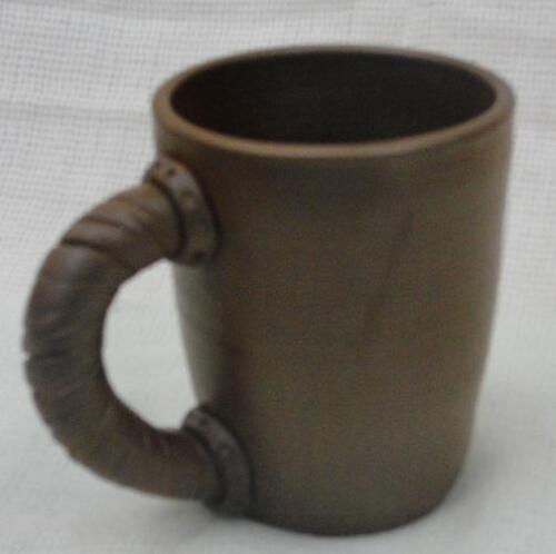 Глиняная кружка